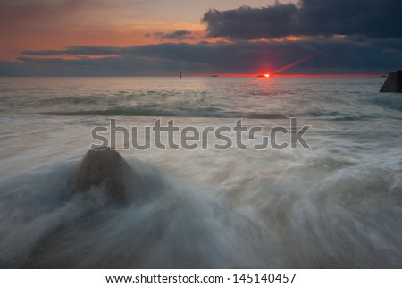 Beautiful sunrise over the sea - stock photo