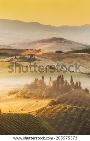 Beautiful sunrise over the Val d'Orcia in Tuscany, natural park included in the heritages list of UNESCO - stock photo