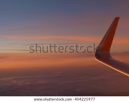 Beautiful sunrise view from the airplane window - stock photo