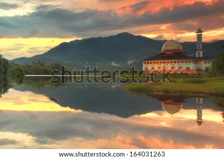 Beautiful sunrise with reflection at Darul Quran mosque, Malaysia - stock photo