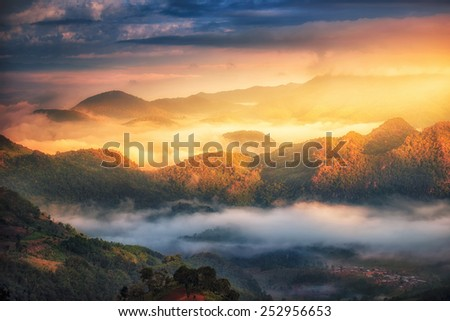 Beautiful sunrise with the morning mist, at doi angkhang in Chiangmai,Thailand  - stock photo