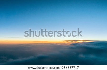 Beautiful sunset above the clouds - stock photo