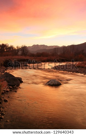 Beautiful sunset above the Provo River, Midway, Utah, USA. - stock photo