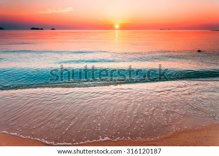 Beautiful sunset above the sea, view from the beach - stock photo