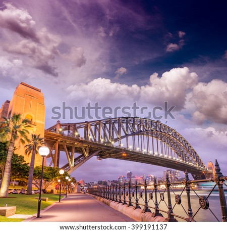 Beautiful sunset across Sydney Harbour Bridge. - stock photo