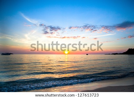 Beautiful sunset and sea beach in Thailand. - stock photo