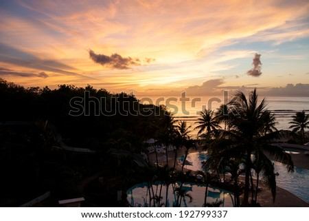 Beautiful sunset at a beach resort in the tropics - stock photo