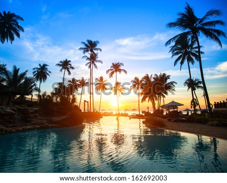 Beautiful sunset at a beach resort in tropics. - stock photo