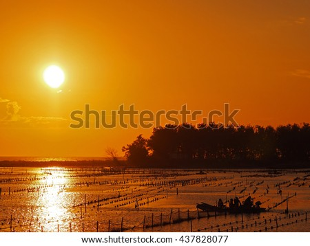 Beautiful Sunset at beach in Tainan - stock photo