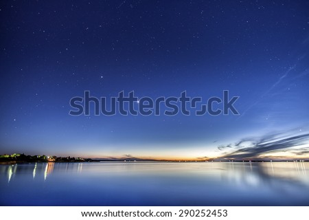 Beautiful sunset at dusk with stars above - stock photo