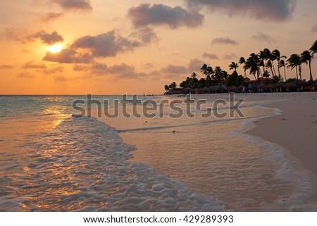 Beautiful sunset at Manchebo beach on Aruba island - stock photo