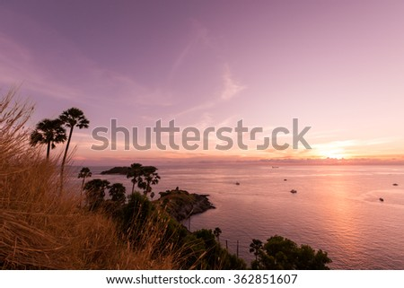 Beautiful sunset at Promthep cape view point, Phuket, Thailand. Purple filter. - stock photo
