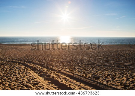Beautiful sunset beach in Portugal. Great place for learning how to kite. - stock photo
