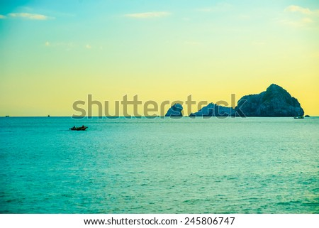 Beautiful sunset in Ha Long Bay viewed from Cat Ba island, Vietnam - stock photo
