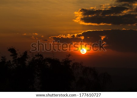beautiful sunset in the autumn landscape of the mountain - stock photo