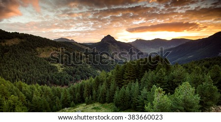 beautiful sunset in the mountains, panoramic views of the mountains and the sunset sky slopes. Photo of a large size, resolution - stock photo