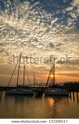 Beautiful sunset in the port of sailing - stock photo