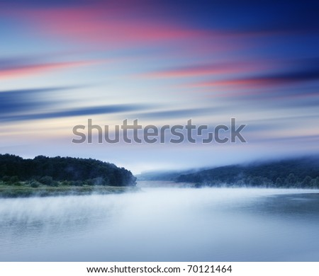 Beautiful sunset in the river. Evening HDR image - stock photo