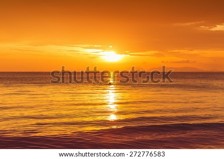 beautiful sunset in yellow as background - stock photo