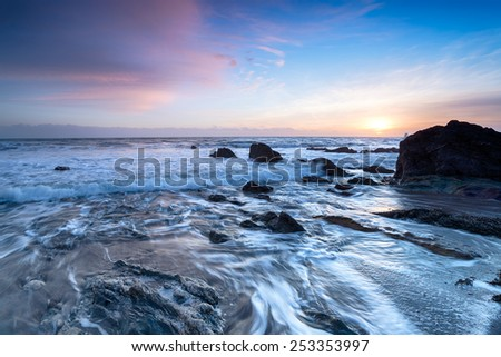 Beautiful sunset on the south coast of Cornwall at Portwrinkle on Whitsand Bay - stock photo