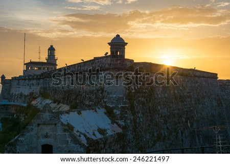 Beautiful sunset outside El Morro, a Spanish colonial fortress designed to defend Havana city, the place is a famous tourist landmark in Cuba - stock photo