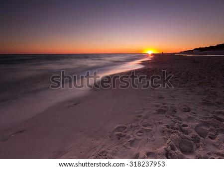 Beautiful sunset over Baltic sea. Summer landscape of polish sea beach. - stock photo