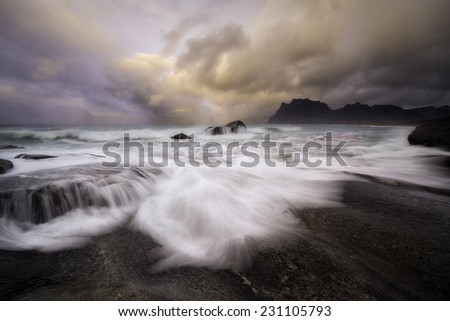 Beautiful sunset over lofoten islands, norway, in a stormy day - stock photo