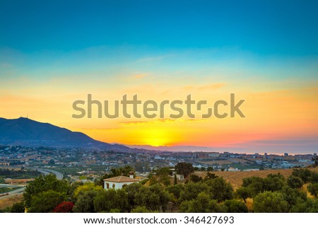 Beautiful Sunset Over Mountain, Mediterranean sea and town Mijas, Spain. - stock photo