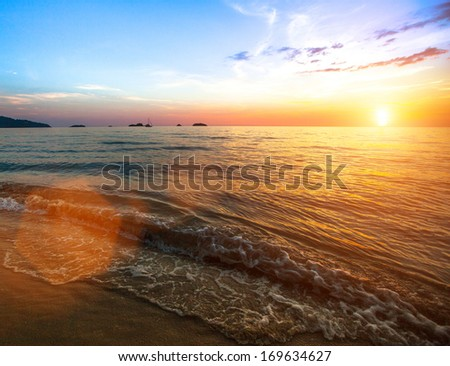 Beautiful sunset over ocean, nature composition. - stock photo