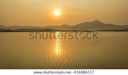 beautiful sunset over river - stock photo
