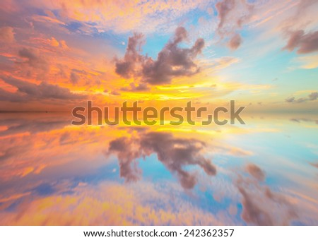 Beautiful sunset over sea with reflection in water - stock photo