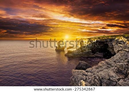 Beautiful sunset over the calm ocean - stock photo