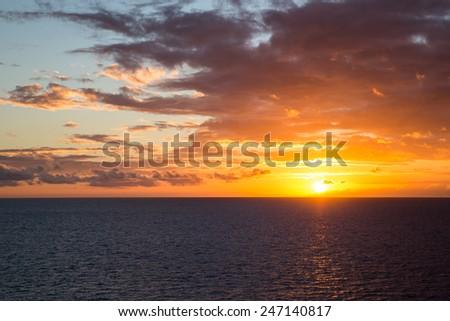 Beautiful sunset over the Caribbean Sea. - stock photo
