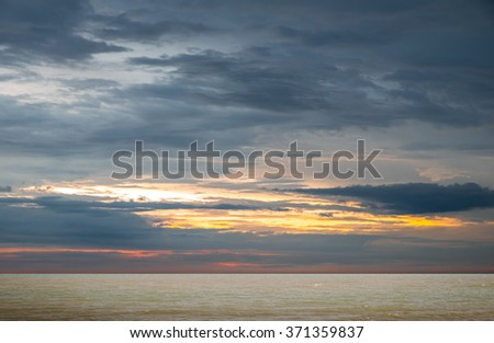 Beautiful sunset over the horizon in the sea, Phetchaburi Province, Thailand. - stock photo