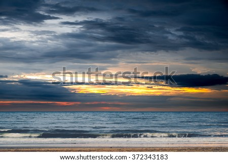Beautiful sunset over the horizon in the sea, Phetchaburi Province, Thailand - Dark tone coler - stock photo