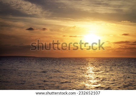 Beautiful sunset over the reservoir. Sunrise in the sea - stock photo
