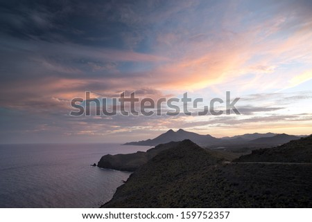 beautiful sunset over the sea in cabo de gata, spain - stock photo