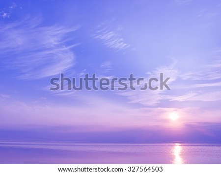 Beautiful sunset over the sea of blue and violet colors - stock photo