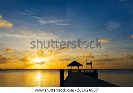 Beautiful sunset over tropical sea - stock photo