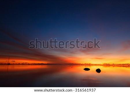 Beautiful sunset over tropical sea - stock photo