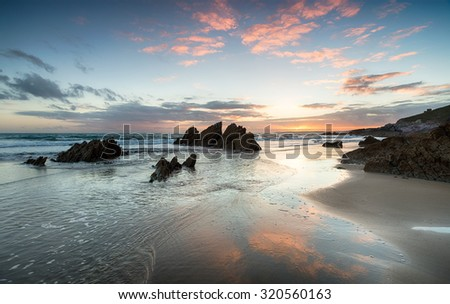 Beautiful sunset over Whitsand Bay beach on the south Cornwall coast - stock photo