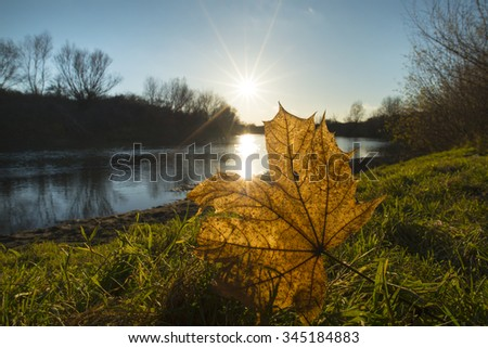 Beautiful sunset over wild river in autumn - stock photo