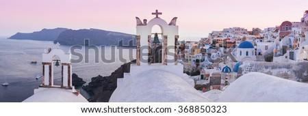 Beautiful sunset panorama in Oia village. Santorini, Greece - stock photo