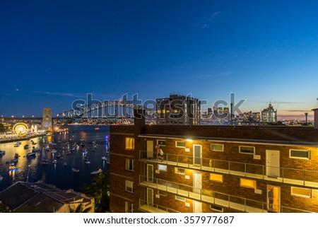 Beautiful sunset scene at Sydney harbor bridge and downtown - stock photo