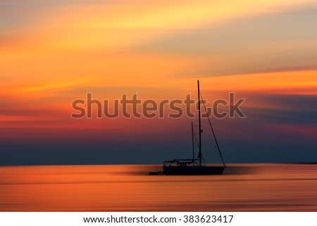 Beautiful sunset seascape - colorful sea background with a yacht - stock photo