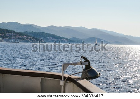 Beautiful sunset seen from sailing boat, with shining blue sea, yachts and mountains. Summer background - stock photo