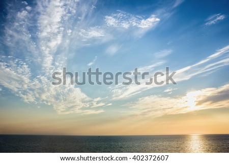 Beautiful sunset sky at the beach near the sea - stock photo