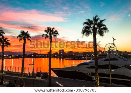 Beautiful sunset sky in the marine port. Close up ship. Port of  - stock photo