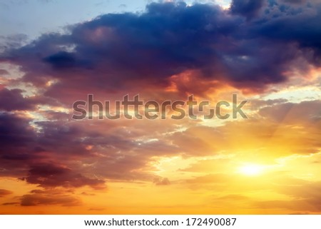 Beautiful sunset sky with sun. Sky background.  - stock photo