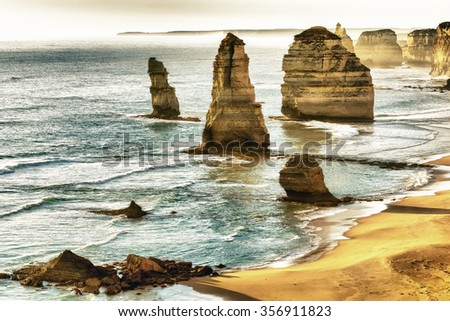 Beautiful sunset view at coast of Twelve Apostles by Great Ocean Rd, Australia. - stock photo